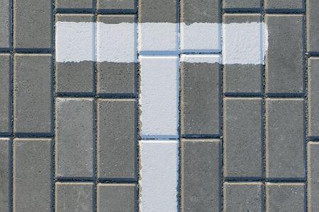 White dividing line on paving slabs in a city Park