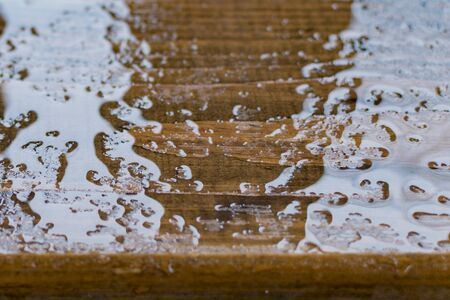 Fragment of a decorative Park bench in rainy weather Imagens