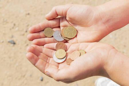 A few coins in a mans hands Banco de Imagens