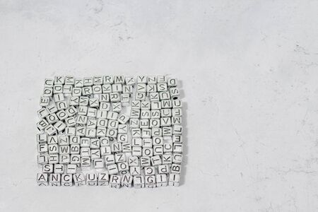 Cubes with letters of the English alphabet on a decorative background