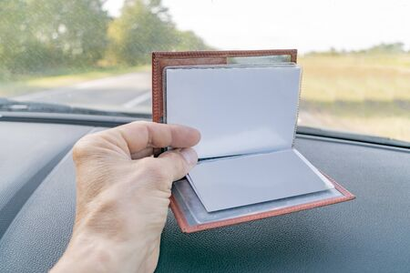 Purse with documents lying on the car panel 스톡 콘텐츠