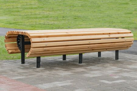 New benches with wooden floors on the waterfront foggy morning Stockfoto