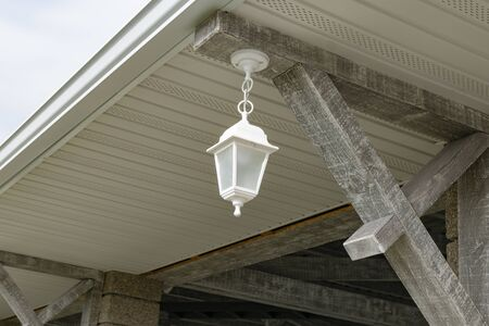 Fragment of a new verandah with lanterns in the city Park Stock Photo