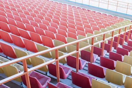 View of the seats of the stands in an empty stadium