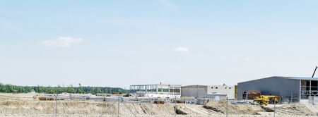 Large construction site of a new production in an open field