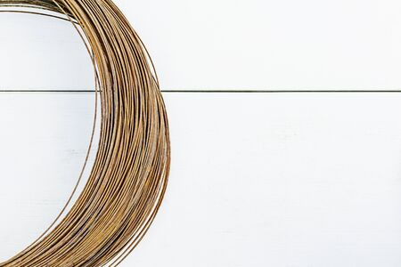 A coil of old rusty wire on a white background 版權商用圖片