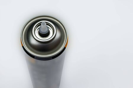 Image of a metal can for mounting foam on a light background