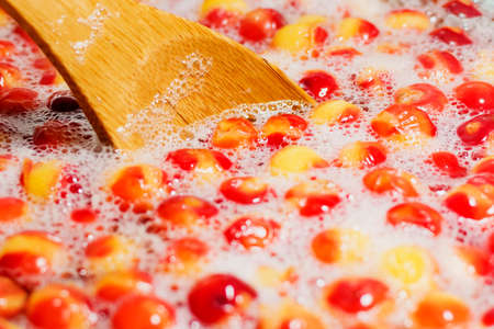 Preparation of fresh compote from berries Archivio Fotografico