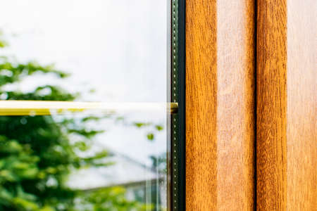 A fragment of a plastic laminated window with partitions in mirrored double-glazed Windows