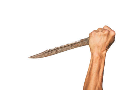 Old rusty knife in the hand of an adult on a white background 免版税图像