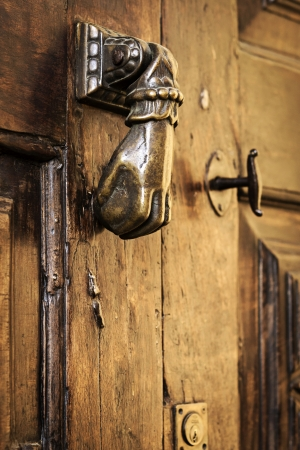 Close-up on an antique door-knocker photo
