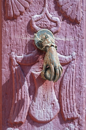 Door handle knocker close up with web photo