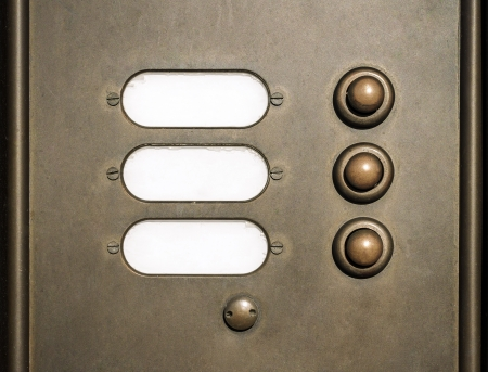 brass doorbell with three buttons