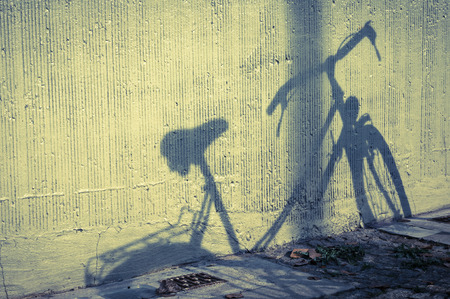 shadow of a bicycle on the wall photo
