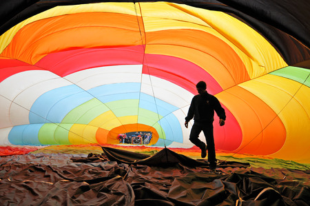 Man inflating a hot air balloon photo