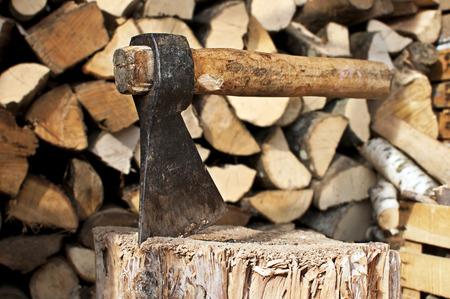 massive ax stuck in a beech stub  Standard-Bild