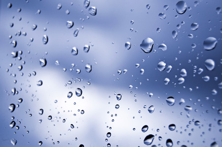 Rain drops on a window s glass photo