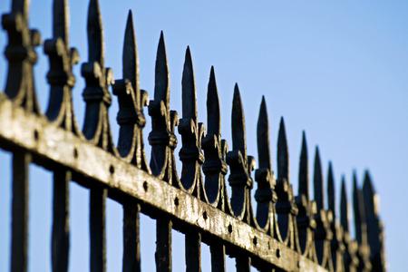 decorative steel gate against blue sky
