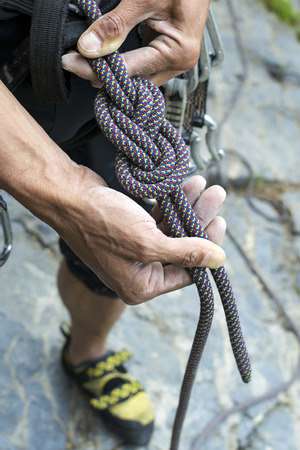 climber doing a figure eight knot re-threaded Stock Photo