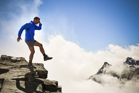 abyss: man stepping into the abyss. Italian Alps