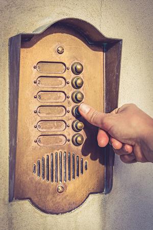 Finger ringing a door bell vintage