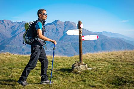 trekker: Trekker at crossroad. Italian Alps
