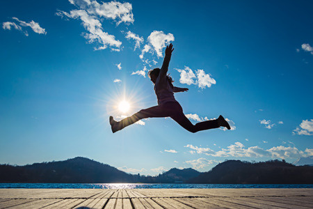 freedom nature: Girl jumping in the sun