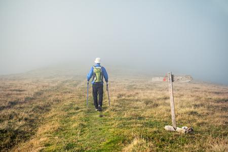 loosing: Man loosing his path in the fog