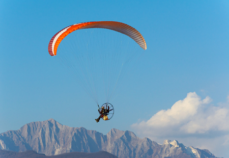 engine powered: Man paragliding with powered paraglider Stock Photo