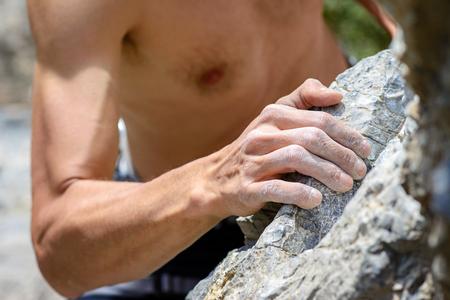 Mans hand holding grip