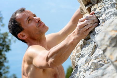 Man climbing on limestone. Muzzerone mountain, Italy