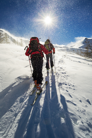 snowstorm: ski mountaineering in snowstorm Stock Photo