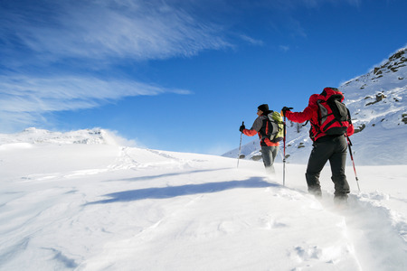 ski mountaineering in snowstorm Stock Photo