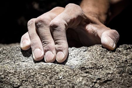 Mans hand climbing on granite. Italian Alps