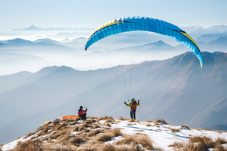 taking picture to a paraglider takeoff on the mountain. Italian Alps