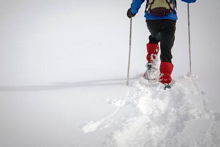 winter trekking in a beautiful sunny day. Italian Alps