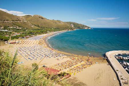 Panoramic view of Sperlonga golden sandy beach with the ancient roman Tiberius Villa. Italian Holidays.