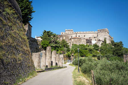 Beautiful Sermoneta village with old ruined columns, medieval houses and the famous Caetani Castle on the top of the hill. Traditional Italian landscape