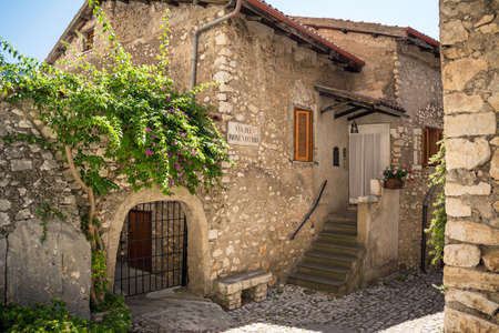 A road between the stone walls of Sermoneta, little medieval town in the Lazio region. Italy
