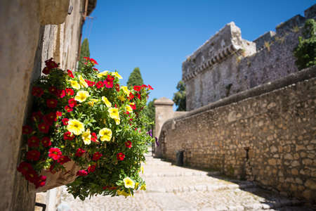 Colorful Flower Bouquet in the beautiful Sermoneta village with medieval houses and the famous Caetani Castle on the top of the hill. Italy