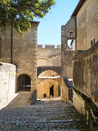 Beautiful Sermoneta village with medieval houses and the famous Caetani Castle on the top of the hill. Traditional Italian landscape