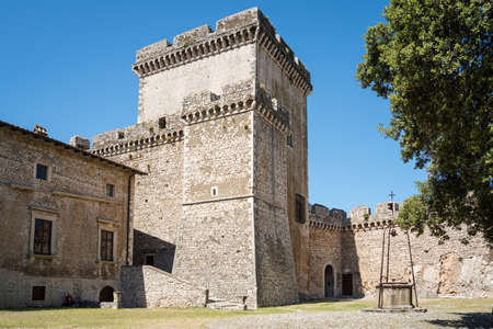 the stone walls and the tower of the famous Caetani Castle of Sermoneta, little medieval town in the Lazio region. Italy Editorial