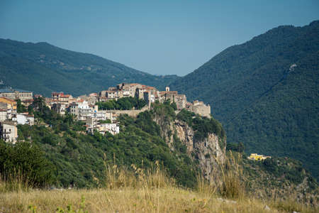 Beautiful Norma village with ancient romanesque ruins and medieval houses on the top of the hill. Traditional Italian landscape