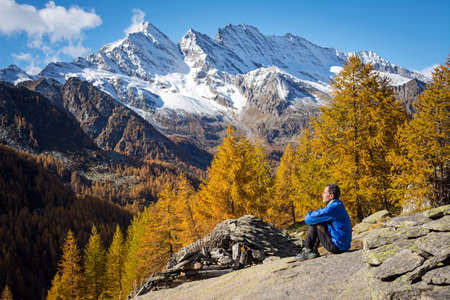 Trekker relaxing on the mountains. Gran Paradiso National Park. Italy