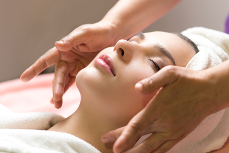 close-up portrait of young beautiful woman in spa environment. closed eyes Stock Photo