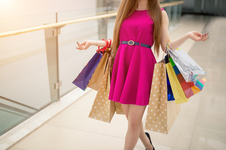 close up woman walking with shopping bags