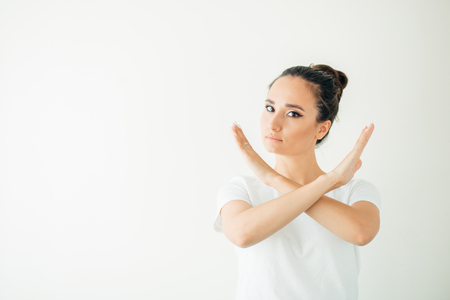 A woman making stop gesture with her hand.