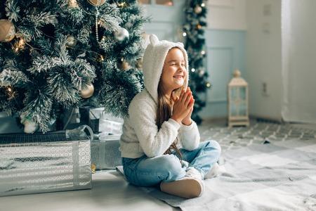 Christmas. Small girl asking santa for the gifts on christmas Stock Photo