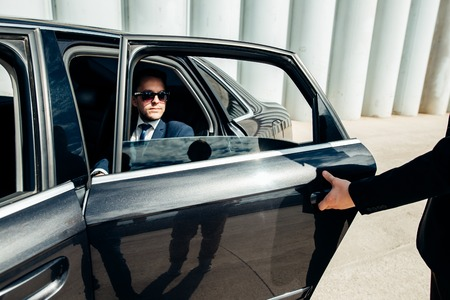 Cropped image of businessman opening door on his car Stock Photo