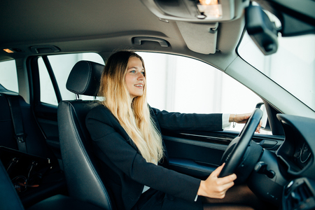 transportation and vehicle concept - close up of businesswoman driving car